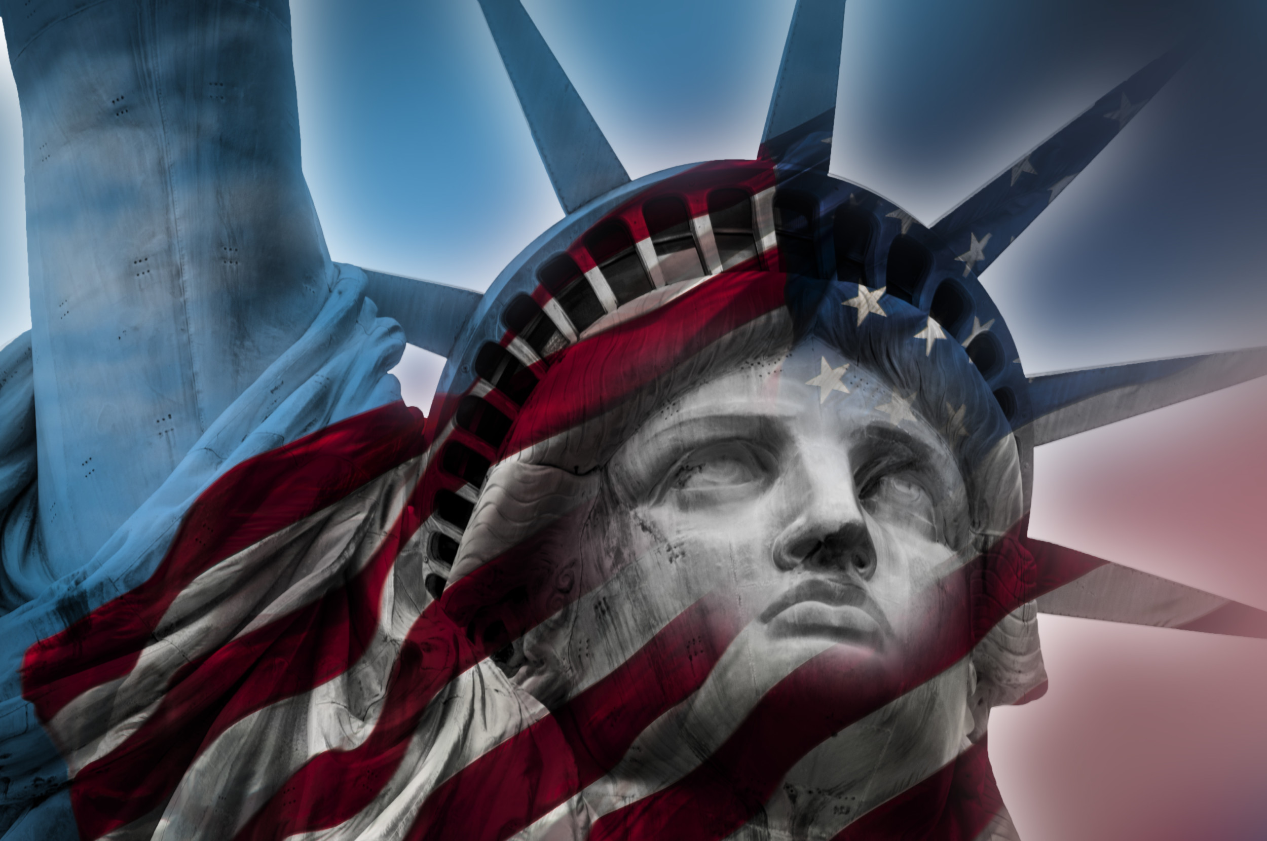 Double exposure image of the Statue of Liberty and the American flag